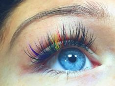 Rainbow colored eyelash extensions! Done by me on my gorgeous client with these beautiful blue eyes for Rhode Island Pride !