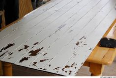 """Diy: How to make a Distressed Faux Vintage Door using inexpensive """"Economy Plank Paneling"""" (Home Depot/Lowes) - Tutorial + cool faux finish technique using layers of wood stain and paint."""