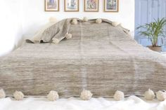 Moroccan bed spread, blanket, throw or rug with pompoms  on either end, woven by hand, 100% pure wool.