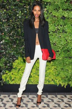 Grace Mahary takes high-contrast suiting from day to evening with a leather bra top and red lip.