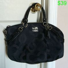 Beautiful black Coach purse This was my very first Coach purse. I bought it at a Coach store. It has been very well taken care of! Beautiful teal lining inside, looks brand new. Comes with dust bag. Coach Bags