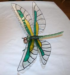 The body is made of metal componants that had to be assembled and painted, it has a 10 inch wingspan. Dragonfly Stained Glass, Dragonfly Wall Art, Making Stained Glass, Glass Butterfly, Stained Glass Designs, Stained Glass Projects, Stained Glass Patterns, Stained Glass Art, Mosaic Glass