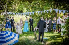 The father of the bride delivering an informal speech to the wedding guests.