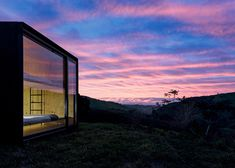 Architecture studio MAPA has revealed the latest project from its prefabricated building company Minimod, a pair of factory-made houses at an estate surrounded by mountains in Brazil