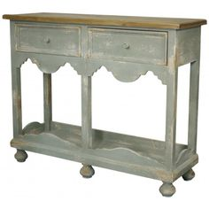 This beautiful vintage gray distressed accent table features two storage drawers! We LOVE the feet of this table!