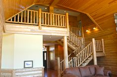 rustic interior log staircase and railing