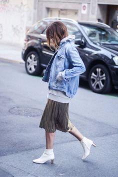 With denim jacket, oversized sweatshirt and metallic pleated skirt