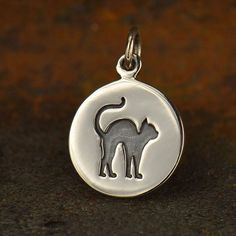 A personal favorite from my Etsy shop https://www.etsy.com/listing/292950729/sterling-silver-etched-cat-charm