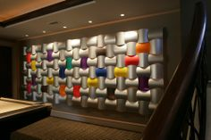 Colorful modular Wovin Wall artwork for the area around the pool table. Backlit and lighted from above. Change the colors and designs as you want.