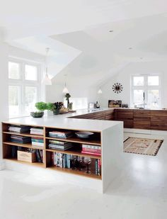 Nordic #white and #natural_wood cabinets for this #kitchen in a 1915 villa in Oslo. Ethic details.