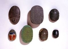 Green serpentine heart-scarab; striated elytra; eleven rows of Hieroglyphic text on base including name of Wahibramerneith.