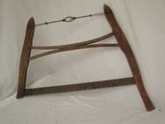 Antique Saw  - the one in my attic is going on the 3 season room wall.  :)