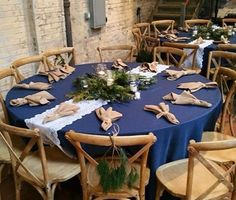 Our farm chairs look perfect against this navy and with the touch of greenery!