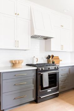 White Upper Cabinets with Charcoal Gray Lower Cabinets - Transitional - Kitchen Grey Kitchen Cabinets, Kitchen Cabinet Colors, Kitchen Redo, Home Decor Kitchen, Kitchen Interior, Home Kitchens, White Appliances In Kitchen, Kitchen Ideas, Condo Kitchen Remodel
