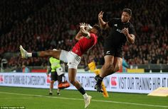 Anthony Watson of the Lions manages to grab hold of a high kick ahead of New Zealand's Ta. British And Irish Lions, New Zealand, Kicks, Tours