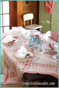 Vintage Quilt as a Table Cloth/I love the colors here and the blue jars..