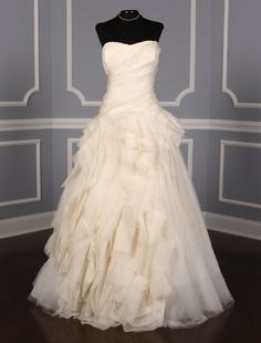 This 100% Authentic Vera Wang Diana wedding dress is from the Luxe Collection!  The gown is a gorgeous combination of tissue organza, satin faced organza & silk tulle. You will save thousands of dollars on this couture wedding dress! Now up to 90% Off Retail! #verawang