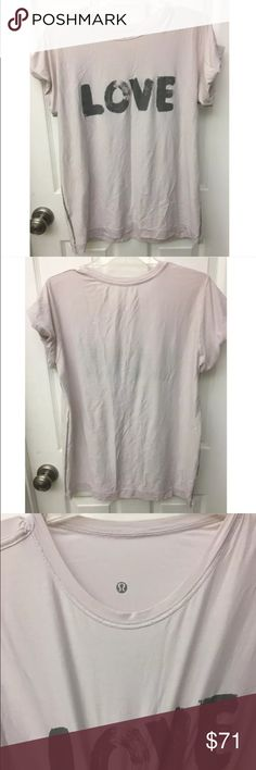 Lululemon Pale Pink Love Graphic T-Shirt 2 Lululemon logos, one inside and one outside! No size tag, fits like a large! Super cute layered with a cami or sports bra underneath! ⚜️I love receiving offers through the offer button!⚜️ Great condition, as seen in pictures! Fast same or next day shipping!📨 Open to offers but I don't negotiate in the comments so please use the offer button😊 lululemon athletica Tops Tees - Short Sleeve
