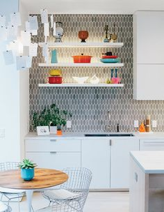 Hexagonal grey tiles pair with off-white custom cabinetry at a light-filled home in San Francisco. This originally appeared in Light-Filled Renovation Brings Cohesion to San Francisco Home.