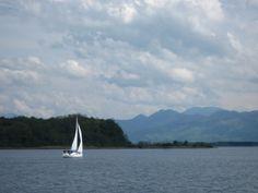 Pretty sailboat on Herrenchiemsee lake in Germany.