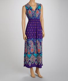 Look fun and flirty in a vibrant maxi. This sleeveless piece boasts a flowing silhouette and rich paisley print that highlight a woman's natural beauty, while the elasticized smocked waist gently hugs the body for a comfortable fit!