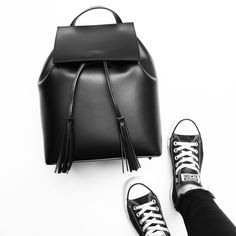 OVRSLO wearing Converse sneakers & a Camelia Roma backpack. #ovrslo #converse #cameliaroma