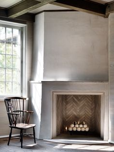 "We love the simplicity of this corner fireplace where it seems as if the ""Girl with a Pearl Earring"" just walked away. We love the simplicity of this corner fireplace where it seems as if the ""Girl with a Pearl Earring"" just walked away. Home Fireplace, Fireplace Surrounds, Fireplace Mantels, Fireplace Ideas, Mantles, Corner Fireplaces, Stone Fireplaces, Stone Fireplace Designs, Monsaraz"