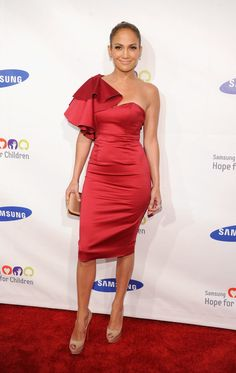 Fiery red and curve-hugging for an event in 2011. | Jennifer Lopez's 71 Sexiest Styles Ever | POPSUGAR Fashion Photo 52