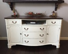 Antique buffet / sideboard lightly distressed. Her dainties Valspar chalk paint finished with clear wax. Minwax special walnut top, with satin polyurethane top coat. All original hardware.