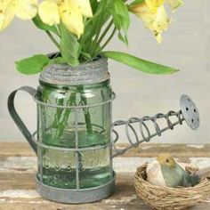 This mason jar watering can vase is adorable.