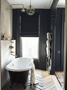Black bathroom walls, black&white marble, and reconstructed herringbone hardwood floor.... speedislove: TRENDHOME: JENNA LYONS' FORMER PARK SLOPE HOME...