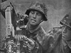 Soldiers of 27. Freiwilligen Grenadier Division Langenmarck with an MG34.