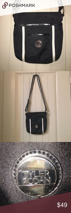 """Black TYLER RODAN Cross-body Purse Bag This is a Black TYLER RODAN Cross-body Purse Bag with a fun satin interior! Lots of pockets to hold all your stuff! Bag measures about 10"""" X 10"""", strap is adjustable to make it a shoulder bag too! Gently used condition! I ship fast! Happy poshing friends! Tyler Rodan Bags Crossbody Bags"""