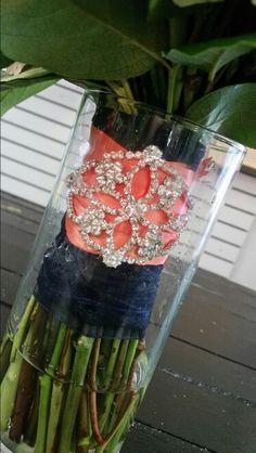 Brides rhinestone bridal bouquet detail. Coral and navy wedding.