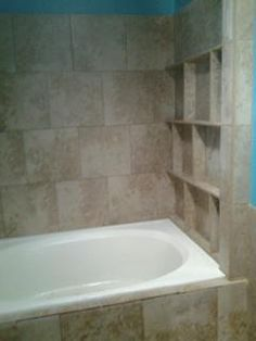 Tile Shelves above the Garden Tub -- perfect for bath tubs now, and candles and other things later...