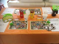 Trash pack table decorations. Laminated placemats using the Gross Gang in your Garbage wallpaper from the Trash Pack website. Masks, design your own trashie and name tags also from the Trash pack website. Bins for drinks and pencils/straws from GoLo and Hot Dollar shop. Boogers from a discount store.