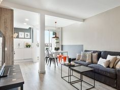 Un apartamento de espacios diáfanos y aire industrial