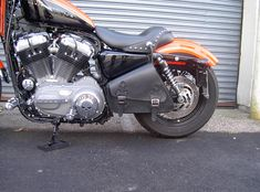 2007 orange over black Harley-Davidson Nightster featuring a Mustang Seat, forward controls and a Sportster Solo Bag from Garage Leathers. Keep your gear warm, dry and safe... http://garageleathers.com/harley-davidson-sportster-solo-bags/ #solobags #garageleathers