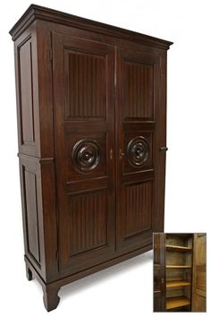 Stained wood armoire with paneled sides, the carved door with rondels and the interior with four adjustable shelves. Armoire Dresser, Antique Armoire, Sideboard Cabinet, Antique Wardrobe, Mirrored Wardrobe, Bookcase Storage, Tall Cabinet Storage, Shelves, Clothes Drawer Organization