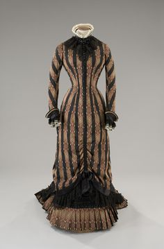Tirelli Costumi, faille day dress with black stripes gold burgundy and black background, ruffled hem and trim, neckline finished with a ruched pleated ivory tulle and black lace, costume designed by Maurizio Millenotti, for Sohie Marceau in Anna Karenina, by Bernard Rose, 1997