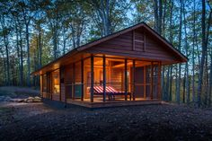 This tiny cabin, designed by Dan Dobrowolski and Kelly Davis, is small enough to meet the size requirements of a luxury RV. It makes the most of its 400 square feet and includes a screened porch.