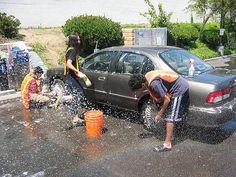 Volunteers for Junior Achievement programs in the Gallatin Valley holding car wash fundraiser in the Bozeman Albertson's parking lot.  All funds raised will support economic education in Gallatin Valley schools, teaching kids about money, entrepreneurship and careers.