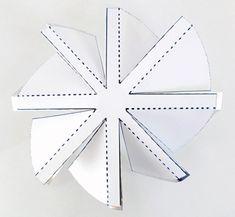Windmill template folded on aluminum circle.