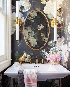 Feeling romantic? Large-scale floral wallpaper, a vintage-style sink, and antique brass fixtures fulfilled Sarah Biondi's love of romantic style. Long, narrow sconces in opal glass and brass bring some industrial-inspired glam. (PS: The pedestal sink and fixtures are vintage finds!) Wallpaper: @elliecashmandesign