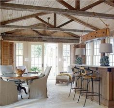 In Good Taste:Carter Kay Interiors - Design Chic - love the dining area and great kitchen with the wood beams! U Couch, Rustic Sunroom, Sunroom Dining, Rustic Wood, Exposed Rafters, Exposed Beam Ceilings, Beamed Ceilings, Exposed Wood, High Ceilings