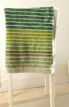 with sticks: Rest o'Hoi | Pinneguri's gorgeous striped blanket, using scraps of yarn. Page is in Norwegian, but with Google Translate's help, go check out the pattern  steeking instructions.