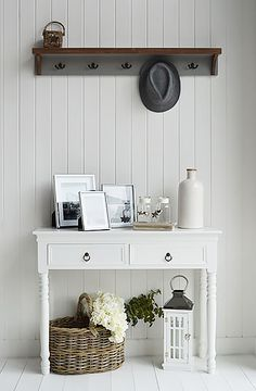 Decorate your hall in grey and white. A picture of The New England white console table with grey Brunswick coat rack
