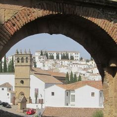 View of Barrio Padre Jesus from under the Arch of Philip V in Ronda.  #arch #ronda #spain #travel #tours #andalucia