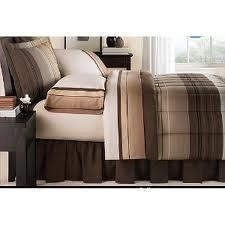 Brown, Gray & Black Plaid Twin Comforter Set bed in a bag by Mstays. $69.93. Rich colors and elegant, high quality fabrics give this Mainstays Ombre Bed in a Bag bedding set infinite slumber appeal. Plush and stylish, this bedding and comforter set will make a welcome addition to your bedroom. The bed set is very easy to care for, and the soft 200-thread count weave ensures a comfortable night's sleep. You'll enjoy reclining across this bed set's stylish, contemporary pa...