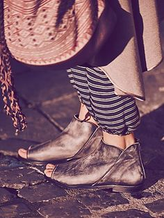 Falcon Flat   Leather shoe boots with a vintage wash, open toe design, and zip back closure for easy on/off.   *By Free People  *Modern and sartorial styles, artisan crafted from fine leathers and premium materials, FP Collection shoes are coveted for their signature cutting-edge aesthetic.